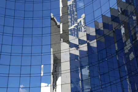 postmodern: Reflections in the windows of building Stock Photo