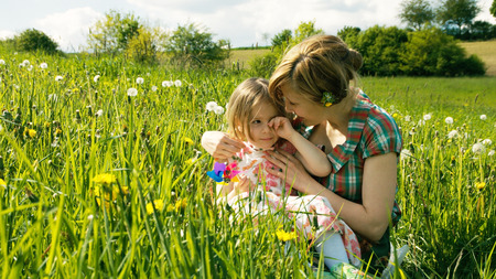 mum and daughter: Mother comforts her daughter on a spring meadow - part 4