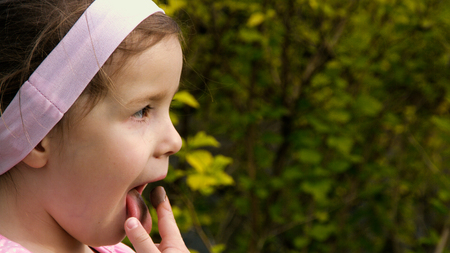 finger licking: A little girl licking chocolate cream from her finger - part 2 Stock Photo