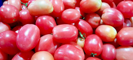 Many tomatoes are sold on the market. vegetable background