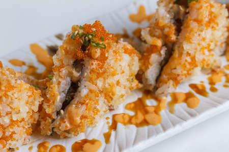 Maguro Onigiri (Japanese Rice Ball) : Rice with Ebiko Wrap with Maguro (Bluefin Tuna) Topping with Sauce, Ebiko and Scallion. Stock Photo