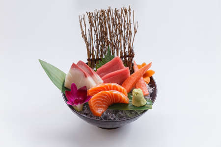 Sashimi Set Include Raw Salmon, Raw Hamachi (Japanese Amberjack), Raw Maguro (Bluefin Tuna) and Kani (Crab Stick) Served with Wasabi in The Iced Bowl.