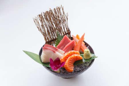 Sashimi Set Include Raw Salmon, Raw Hamachi (Japanese Amberjack), Raw Maguro (Bluefin Tuna) and Kani (Crab Stick) Served with Wasabi in The Iced Bowl.