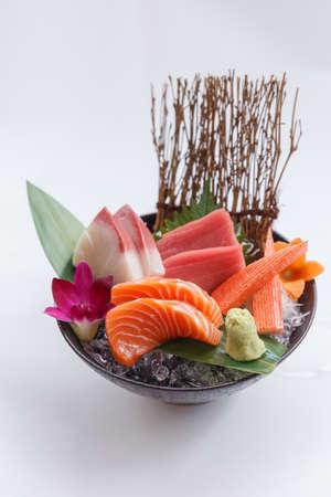 atun rojo: Sashimi Set Include Raw Salmon, Raw Hamachi (Japanese Amberjack), Raw Maguro (Bluefin Tuna) and Kani (Crab Stick) Served with Wasabi in The Iced Bowl.