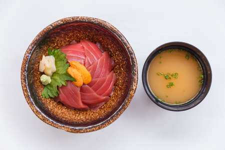 Maguro-Don (Japanese Rice Bowl Topping with Raw Tuna) Topping with Sea Urchin Served with Wasabi and Prickled Ginger. Stock Photo