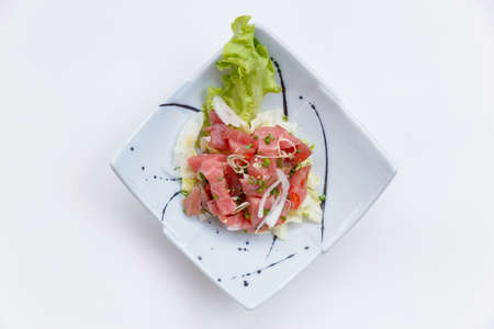 Raw Maguro (Bluefin Tuna) Spicy Salad in Japanese Painted Ceramic Dish.