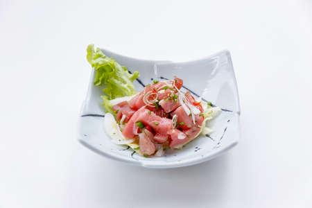 atun rojo: Raw Maguro (Bluefin Tuna) Spicy Salad in Japanese Painted Ceramic Dish.