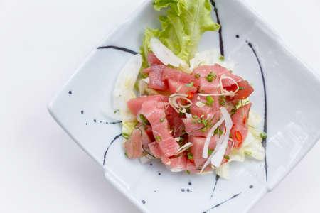 Raw Maguro (Bluefin Tuna) Spicy Salad in Japanese Painted Ceramic Dish.