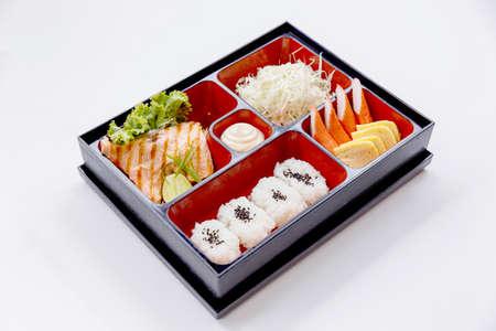 Grilled Salmon Bento with Salad, Kani (Crab Stick) and Tamagoyaki (Japanese Omelette)