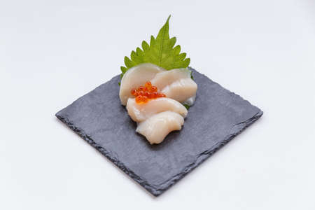 hotate: Hotate (Scallop) Sashimi Served with Ikura (Salmon Roe) and Sliced Radish on The Black Stone Plate.