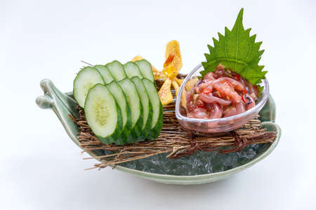 guts: Ika No Shiokara (Japanese Squid Fermented) Served with Sliced Cucumber in the Iced Bowl. Stock Photo