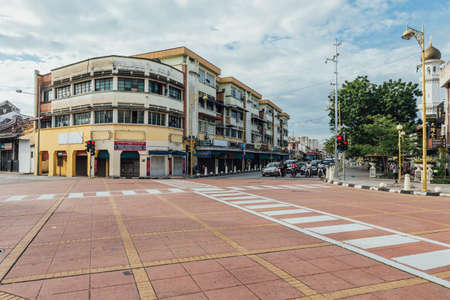 Building and foot path with traffic light on the street at George Town. Penang, Malaysia.