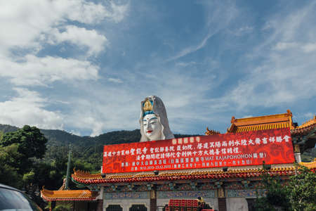 Enormous Guanyin statue over chinese style building at Kek Lok Si Temple at George Town. Panang, Malaysia.
