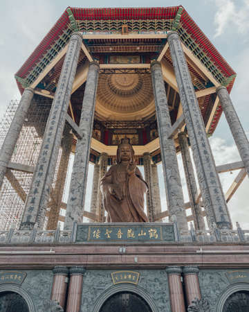 Octagonal pavilion over the 99-foot (30-meter) tall bronze Guanyin statue at Kek Lok Si Temple at George Town. Panang, Malaysia.