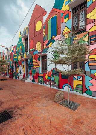 Colorful chinese colonial buildings decorated with wall art painted near the river in Malacca City, Malacca, Malaysia.
