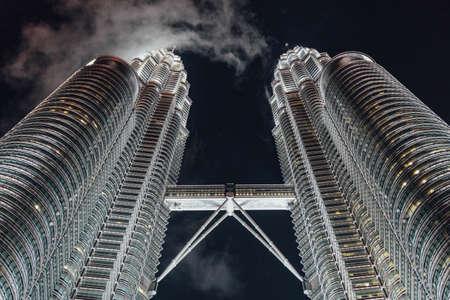 Cloud flew through the Twin Towers at night in Kuala Lumpur, Malaysia