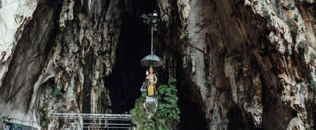 deities: Hindus divine statue in front of the cave of Batu Caves near Kuala Lumpur, Malaysia Stock Photo