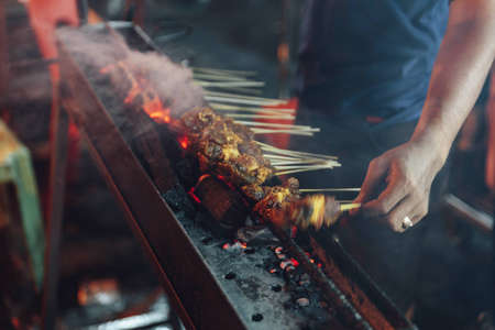 Roasting meat, chicken and mutton satays at the night market in Kuala Lumpur, Malaysia.