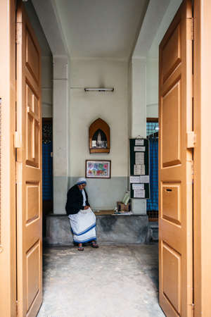 Sister in the entrance of the Missionaries of Charity in Kolkata, India