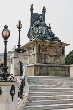 the british museum: Queen Victoria statue with throne in front of  VIctoria Memorial Hall in Kolkata, India