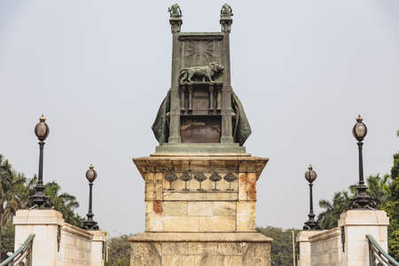 queen victoria: The back of Queen Victoria statue with throne in front of  VIctoria Memorial Hall in Kolkata, India