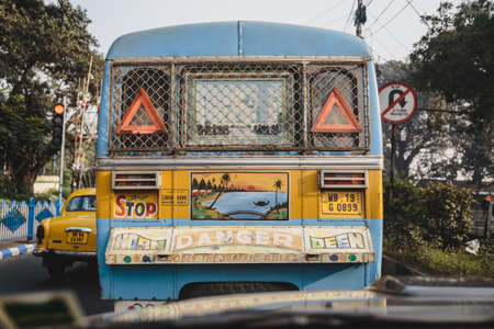 Colorful decoration in the back of the public bus in Kolkata, India. Editorial