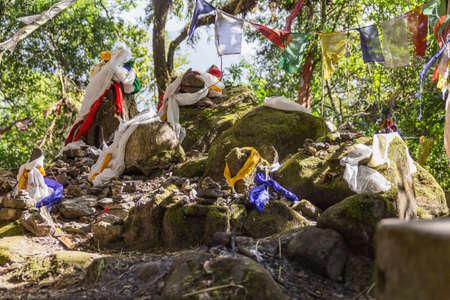 Stone pillars with Tibetan Buddhist prayer flags in Kabi Lungcho, Sikkim, India.