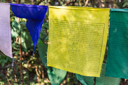 Tibetan Buddhist Prayer Flag include red, green, yellow, blue and white colors in Kabi Lungchok. Sikkim, India.