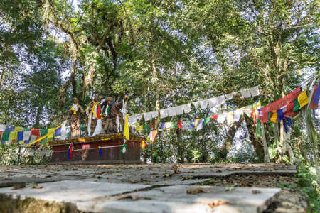 Blood-Brothers statues with Tibetan Buddhist prayer flags in Kabi Lungcho, Sikkim, India.