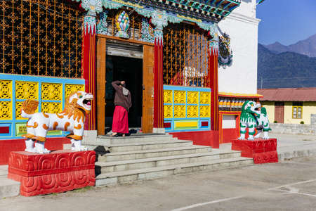 tibetian: Entrance with monk of Tibetan Buddhism Temple in Sikkim, India.