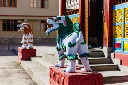 tibetian: Red and blue kirins in front of Tibetan Buddhism Temple entrance in Sikkim, India.