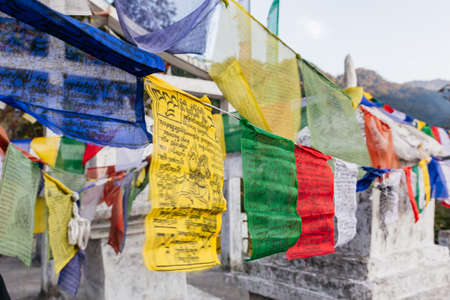 include: Tibetan Buddhist Prayer Flag include red, green, yellow, blue and white colors in North Sikkim, India.