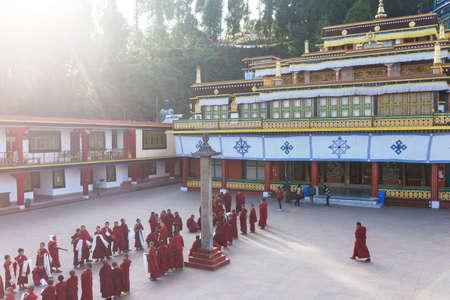 Line of Tibetan monks in front of Rumtek Monastery for welcoming high level monk near Gangtok. Sikkim, India