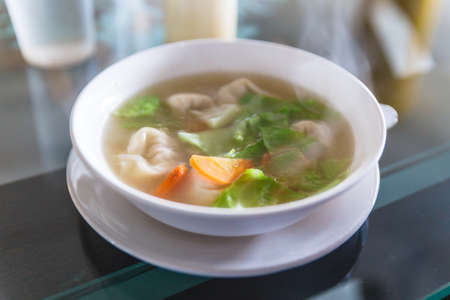 Hot wanton soup with vegetable and steam. Served in the restaurant at Gangtok. Sikkim, India.