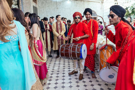 Musicians band wearing red Bandhgala and black Pheta at Indian wedding ceremony in Bangkok, Thailand. Editorial