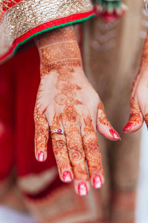 Henna paint on hand for woman at Indian wedding ceremony in Bangkok, Thailand. Stock Photo