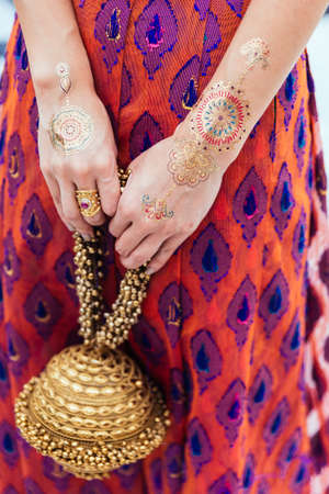 Henna tattoo on both hands and arms for woman at Indian wedding ceremony in Bangkok, Thailand. Stock Photo