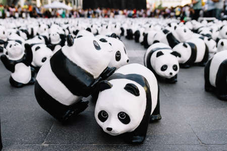 Close up many panda sculptures view from above that place on the floor is an art exhibition in Bangkok, Thailand. Stock Photo