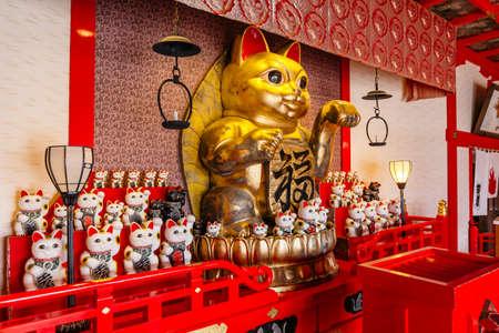 Fortune cats (Nameki Neko) in temple in Noboribetsu Date JIdaimura Historic Village at Hokkaido, Japan.