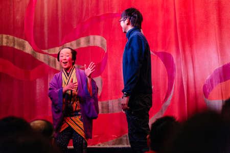 Funny host of Oiran Show (Geisha Show) with selected audience at Noboribetsu Date Judaimura (history theme park highlighting the Edo Period) in Hokkaida, Japan. Editorial