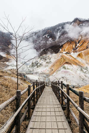 Wood structure walk way of Noboribetsu Jigokudani (Hell Valley): The volcano valley got its name from the sulfuric smell, extremely high heat and steam spouting out of the ground in Hokkaido, Japan.