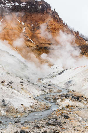 Mineral lake in Noboribetsu Jigokudani (Hell Valley): The volcano valley got its name from the sulfuric smell, extremely high heat and steam spouting out of the ground in Hokkaido, Japan. Stock Photo