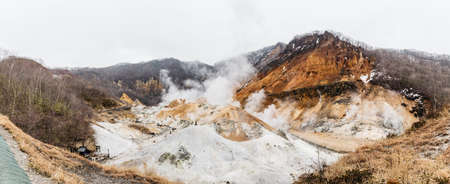 Paranomic view of Noboribetsu Jigokudani (Hell Valley): The volcano valley got its name from the sulfuric smell, extremely high heat and steam spouting out of the ground in Hokkaido, Japan.