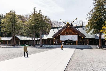 Front of the Hokkaido Shrine (Hokkaido Jingu) with tourists in winter in Sapporo. Hokkaido, Japan. Editorial