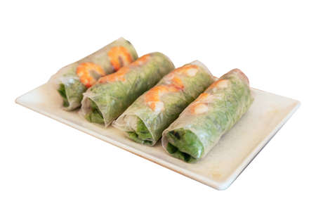 Isolated Vietnamese Fresh Spring Rolls including lettuce and boiled shrimp at the restaurant in Hanoi, Vietnam.