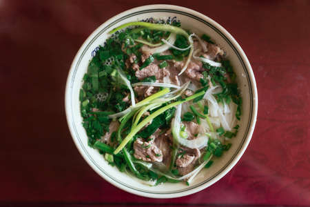 Top view of beef pho including rice noodle, soup and herbs at the restaurant in Sa Pa, Vietnam. Stok Fotoğraf