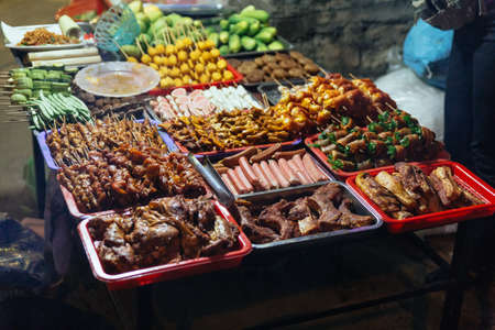 Food for grill such as sausages, meatballs, mushroom, vegetables etc. at the night market in Sa Pa, Vietnam.