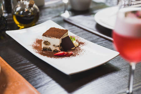 Tiramisu is a popular coffee-flavoured Italian dessert. It is made of ladyfingers dipped in coffee, layered with a whipped mixture of eggs, sugar, and mascarpone cheese, flavoured with cocoa.