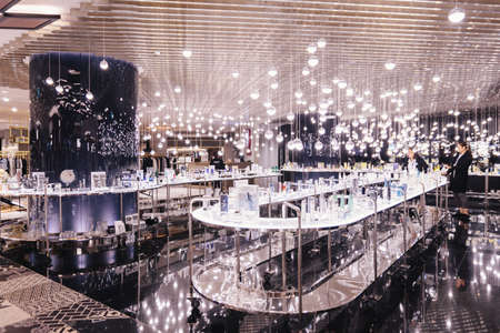 Decorated space with many light bulbs hang from the ceiling. Editorial