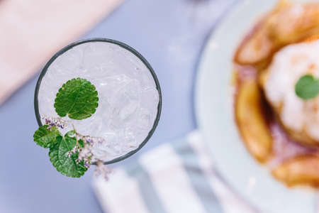 Top view of lime soda with mint leaves and flowers on the top. Stok Fotoğraf